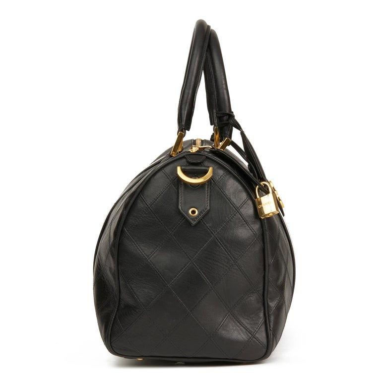 CHANEL Black Quilted Lambskin Vintage Boston 35  Reference: HB2860 Serial Number: 1532126 Age (Circa): 1989 Accompanied By: Lock, Keys, Clochette, Shoulder Strap, Charm Authenticity Details: Serial Sticker (Made in Italy) Gender: Ladies Type: Tote,