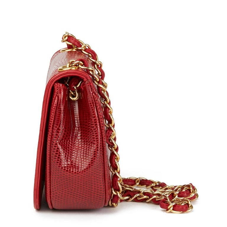 CHANEL Red Lizard Leather Vintage Timeless Mini Flap Bag  Reference: HB2419 Serial Number: 0892769 Age (Circa): 1989 Accompanied By: Chanel Dust Bag, Box Authenticity Details: Serial Sticker (Made in Italy) Gender: Ladies Type: Shoulder  Colour: