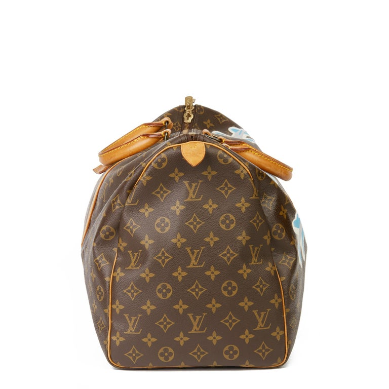LOUIS VUITTON X Year Zero London Hand-painted  'Paper Plane$' Brown Monogram Coated Canvas Keepall 50  Xupes Reference: HB3242 Serial Number: VI 879 Age (Circa): 1989 Accompanied By: Luggage Tag Authenticity Details: Date Stamp (Made in