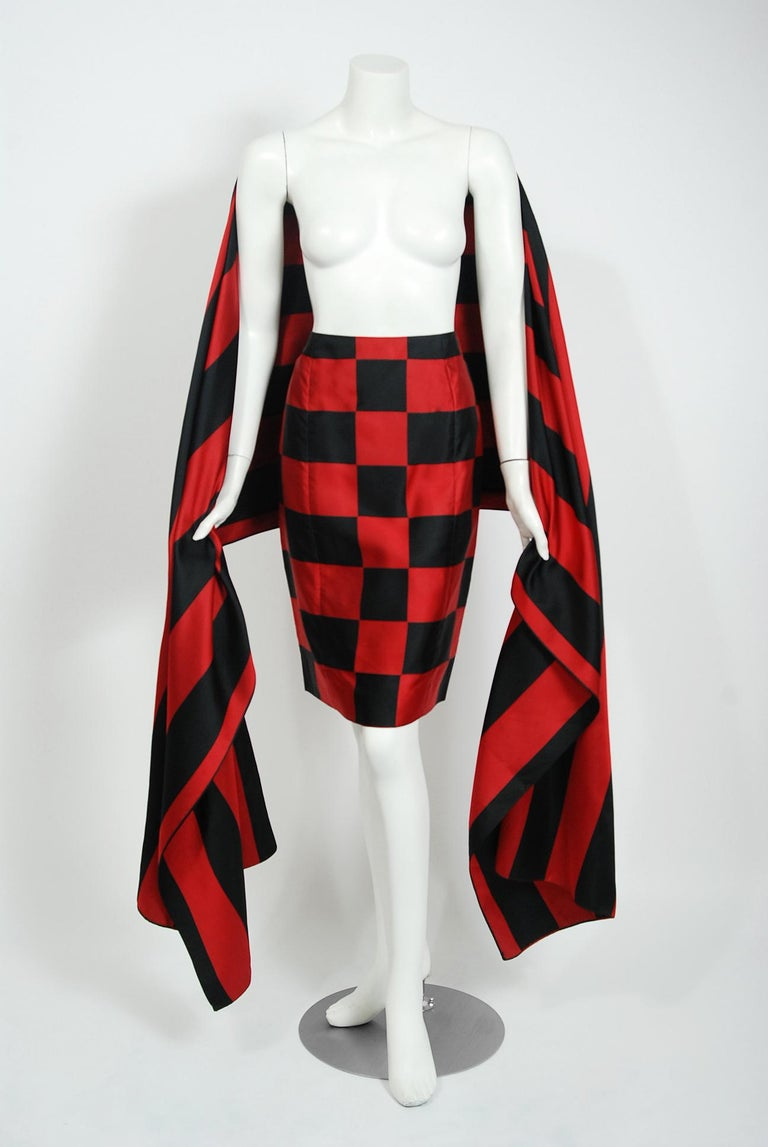 A gorgeous Perry Ellis by Marc Jacobs black and red checkered skirt with matching over-sized shawl wrap from his Fall-Winter 1989 collection. Not only is this rare set very alluring; it is so versatile and easy-to-wear. The minimal design