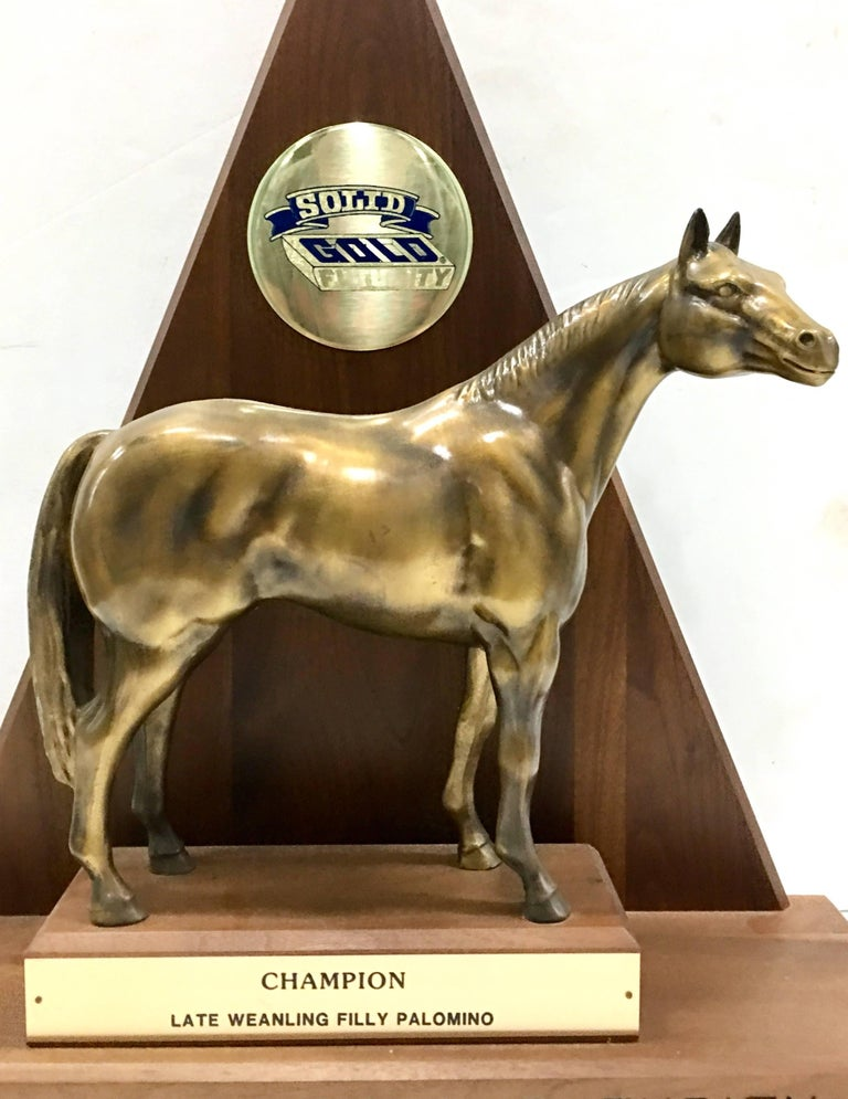 Solid brass and walnut mounted championship horse trophy, 1989. This