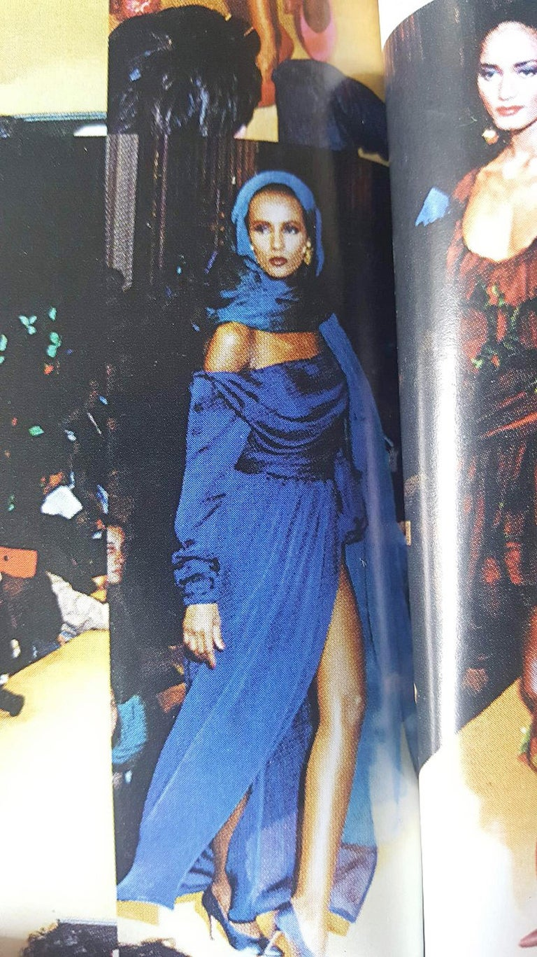 Breathtaking Yves Saint Laurent Haute-Couture gown from his iconic 1989 spring-summer documented collection. It is insanely chic with its fluid grecian goddess construction. The fabric is a luxurious cobalt-blue sheer sheer silk crepe complete with