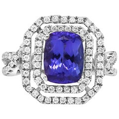 1.99 Carat Emerald Cut Tanzanite and 0.65 Carat White Diamond Ring