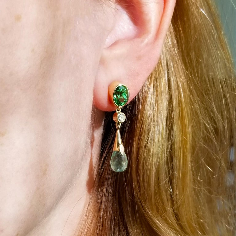 This earring is a masterpiece in understated elegance; it is a style you can easily take from day to night. Tsavorite garnets and mint tourmaline briolettes are an unexpected pairing that work beautifully: the vibrance of the tsavorites is accented