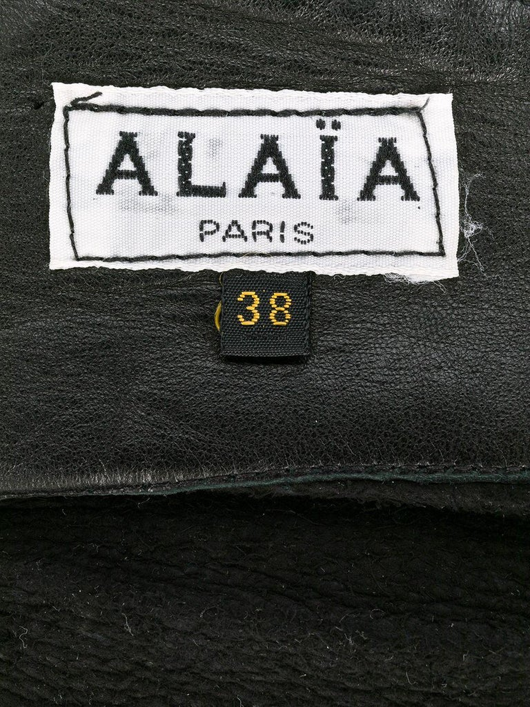 Azzedine Alaïa black soft lamb leather wide corset belt featuring center front pleats, a center back buckle, and an internal logo label. Circa 1990. We attached some photos with the belt worn ( look grey but it is really black as per 1st photo) In