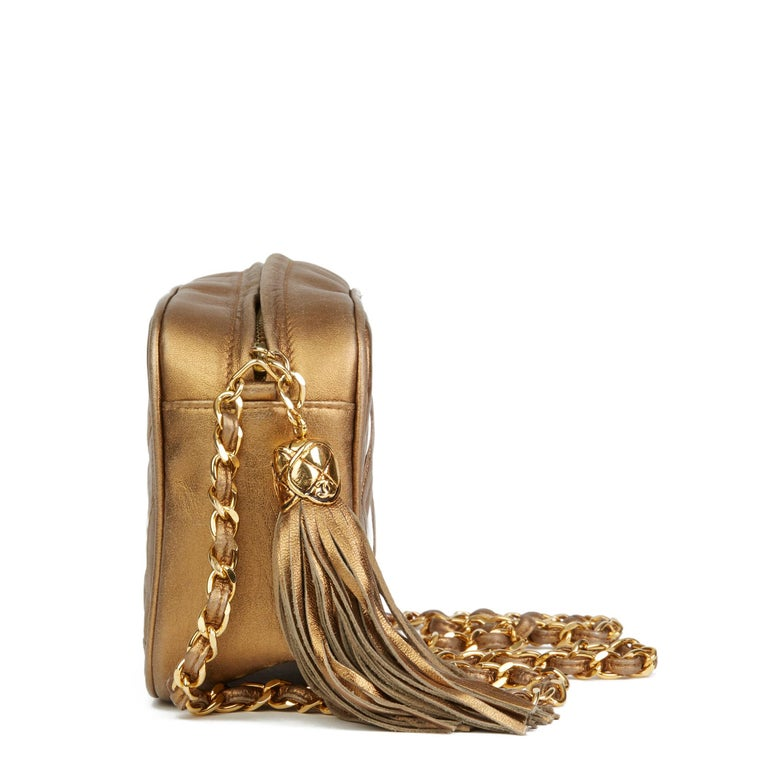 CHANEL Gold Metallic Lambskin & PVC Vintage Naked Camera Bag  Reference: HB2725 Serial Number: 1723244 Age (Circa): 1990 Authenticity Details: Serial Sticker (Made in Italy) Gender: Ladies Type: Shoulder  Colour: Gold Hardware: Gold Material(s):