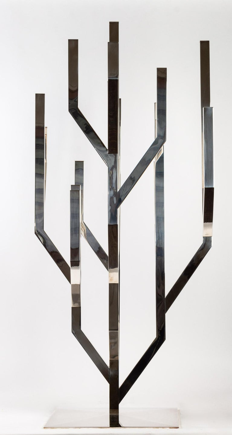 Nature is for Ora-Ïto an inexhaustible source of inspiration. Indoor sculpture, this candelabra shows a free aesthetic interaction between the idea of ??a wild nature, the tree structure of silver material which takes on a plant aspect in the form
