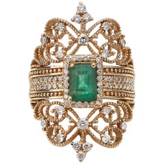 1990s 1.2 Carat Emerald and Diamond Cocktail Shield Ring