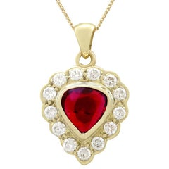 1990s 1.55 Carat Ruby and Diamond 18 Karat Yellow Gold Pendant