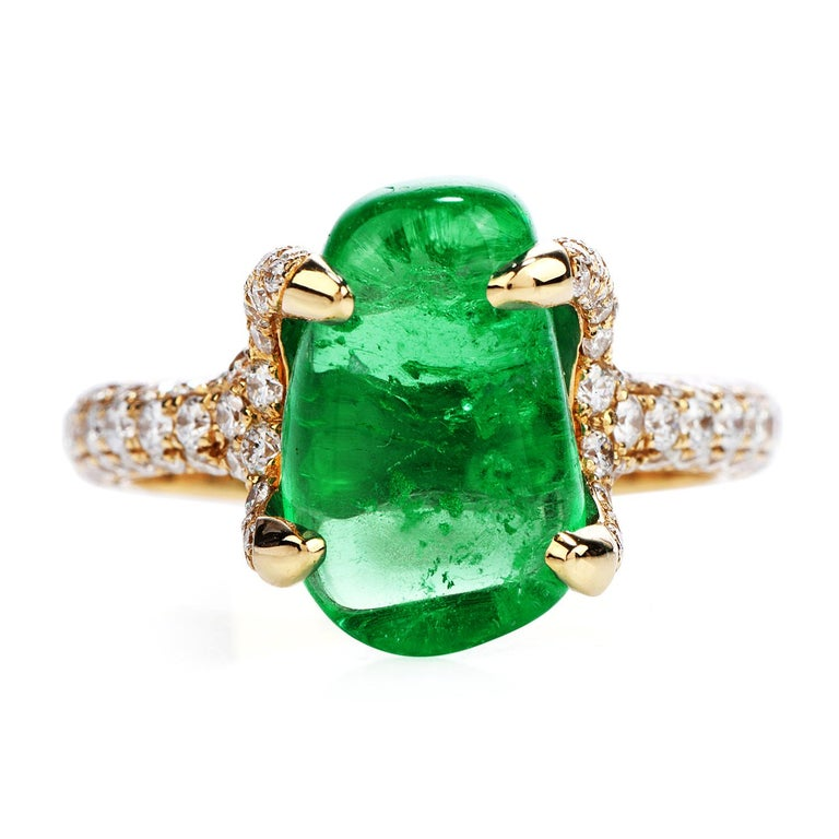 Deep Green & Big Emerald? Yes, please!  This exhilarating Cocktail Ring has a beautiful 6.92ct Colombian Emerald!  With an Oval cabochon cut, held by fourlarge prongs,  It is crafted in solid 18K White Gold,  and it is adorned by Round Cut,pave