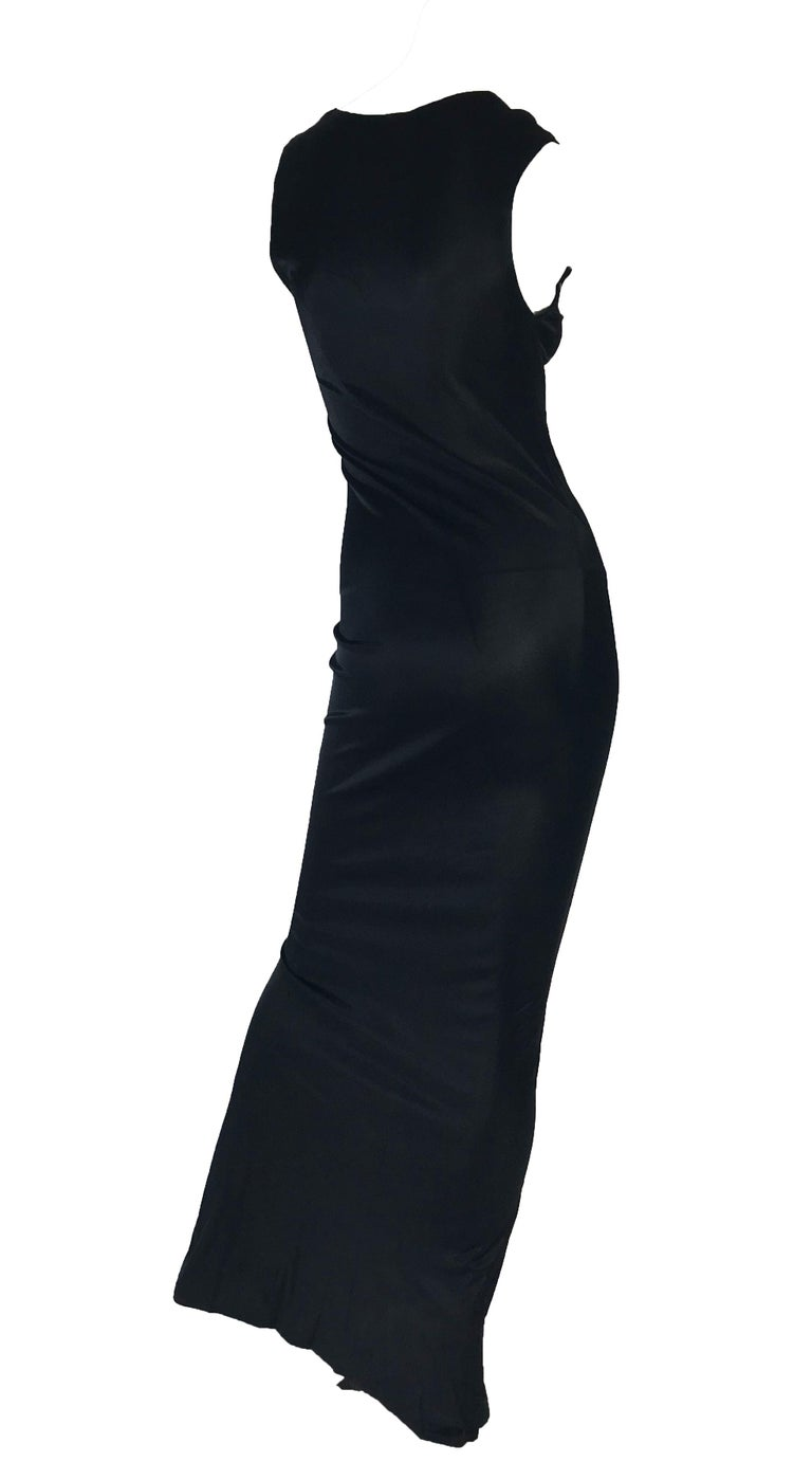 1990s Ann Demeulemeester black form fitting sleevless gown with kick pleat.  Condition: Excellent.  Size 4 - 6