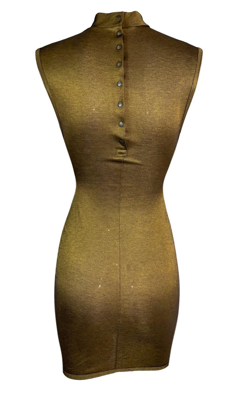 DESIGNER: 1990's Azzedine Alaia  Please contact for more information and/or photos.  CONDITION: Excellent  FABRIC: Viscose & Polyester  COUNTRY MADE: Italy  SIZE: S  MEASUREMENTS; provided as a courtesy only- not a guarantee of fit:  Chest: 25-36
