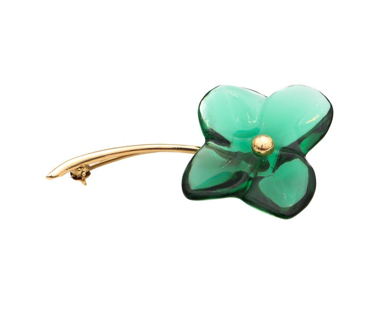 Beautifully crafted 1990s Designer Baccarat Lapel Pin Features a 4 Leaf Clover Design on a stem made of 18 karat yellow gold  Lapel details: Metal: 18 Karat Yellow Gold Weight: 5.5 Grams Designer: Baccarat