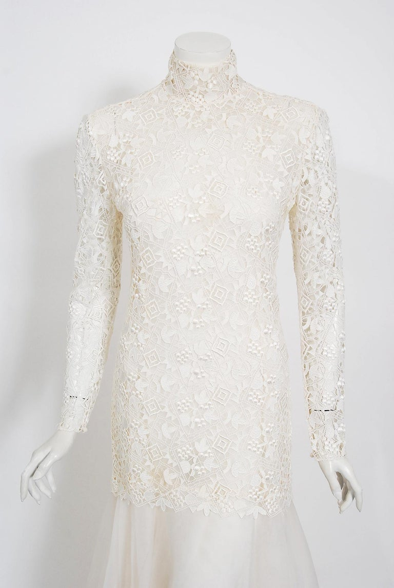 An ethereal early 1990's Bernard Perris Paris Couture ivory lace and silk gown that retailed for over $5,000. At age 16, Perris ventured to Paris, where he eventually was hired as a couture assistant for Guy Laroche. He then went on to design