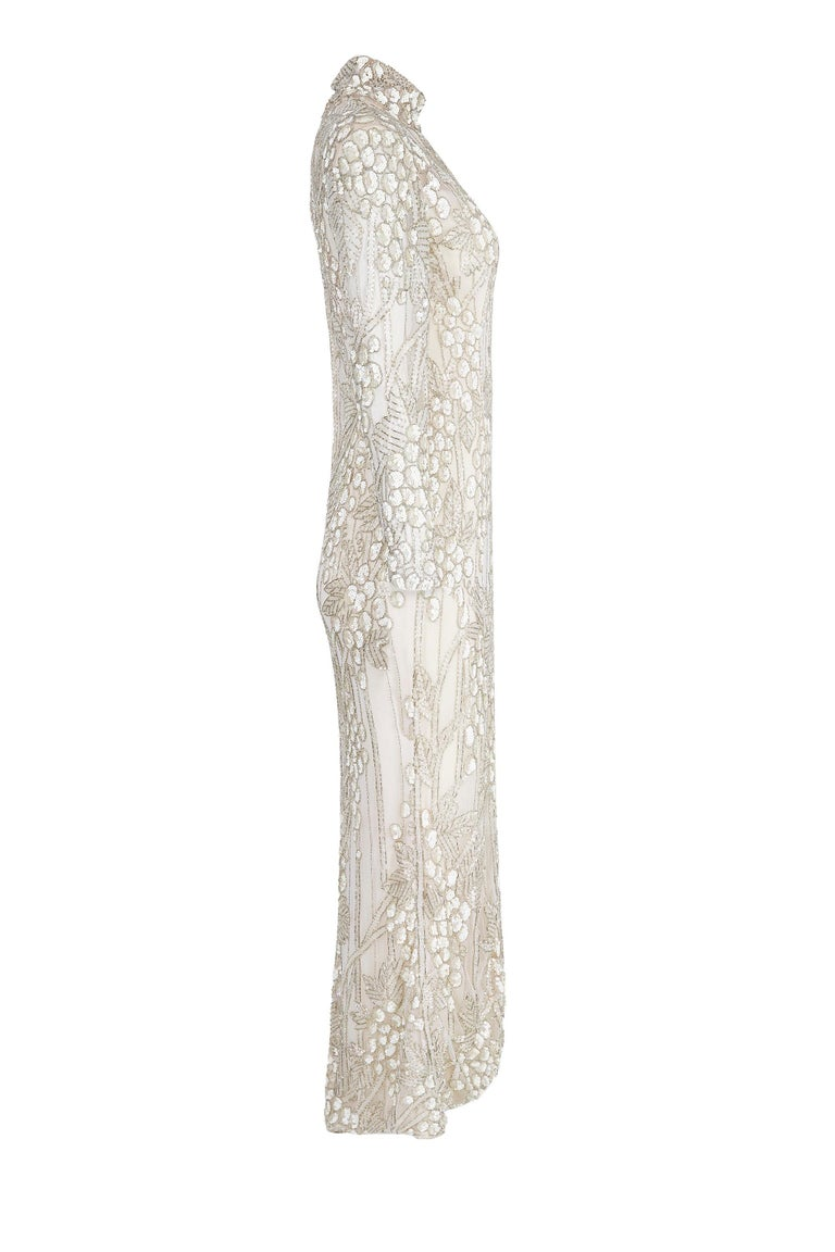This sensational early 1990s ivory silk beaded couture bridal gown is by American designer Bill Mackie who was widely extolled for his on and off screen creations for famous divas such as Diana Ross, Cher and Carol Burnett. His look was synonymous