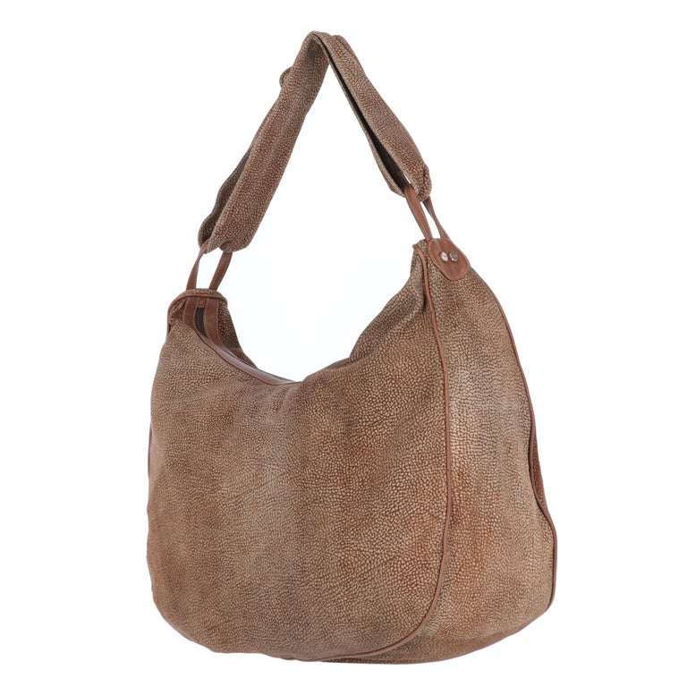 Borbonese beige and brown op print suede tote bag with brown leather details. Zip closure and suede shoulder strap with decorative knot.  The bag shows light signs of wear on the suede, as shown in the pictures.  Years: 1990s Made in Italy  Width: