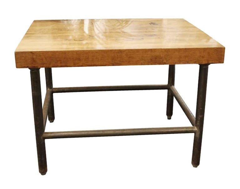 1990s low table with 3 in. thick butcher block top and nicely finished with vintage pipe legs. This can be seen at our 302 Bowery location in Manhattan.