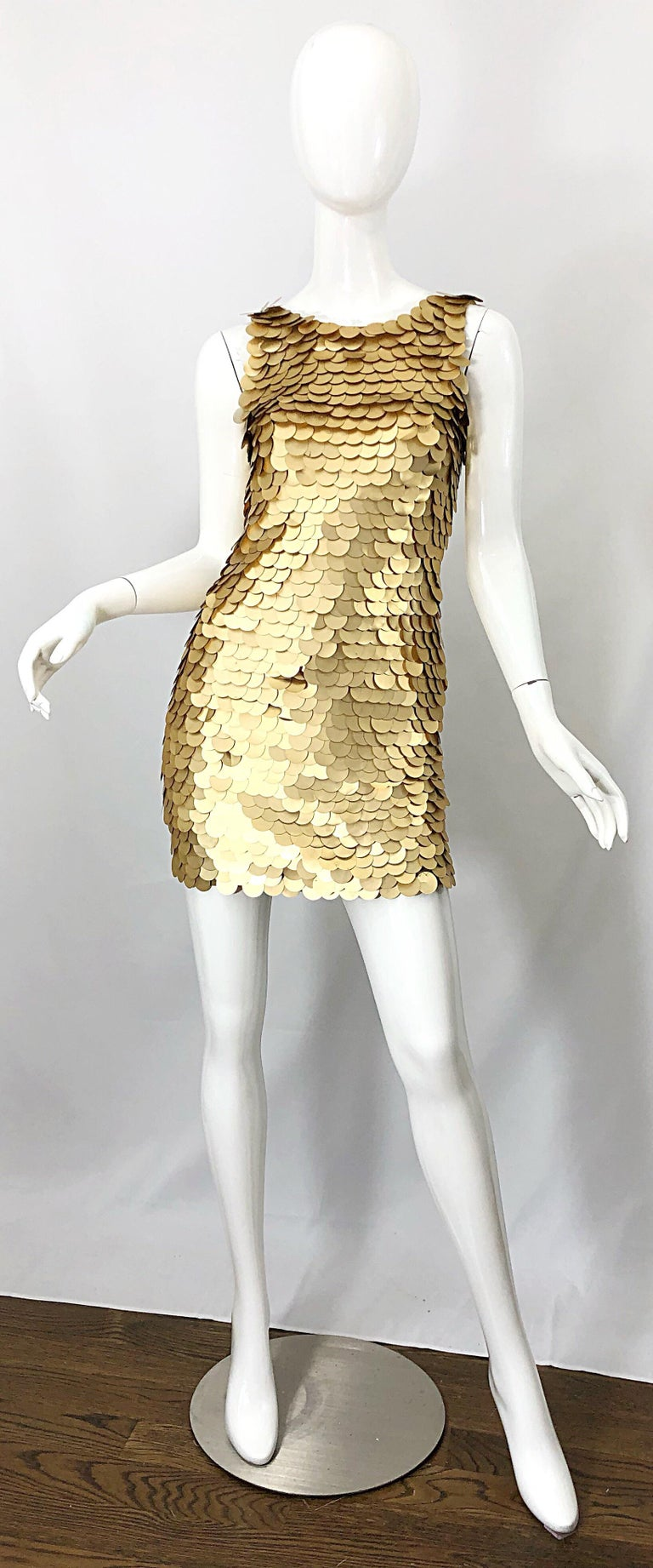 Sexy vintage 90s CD GREENE for BERGDORF GOODMAN gold pailettes sequin bodycon mini dress! Features thousands of hand-sewn matte gold pailettes throghought the entire dress. Simply slips over the head and stretches to fit. A definite statement maker