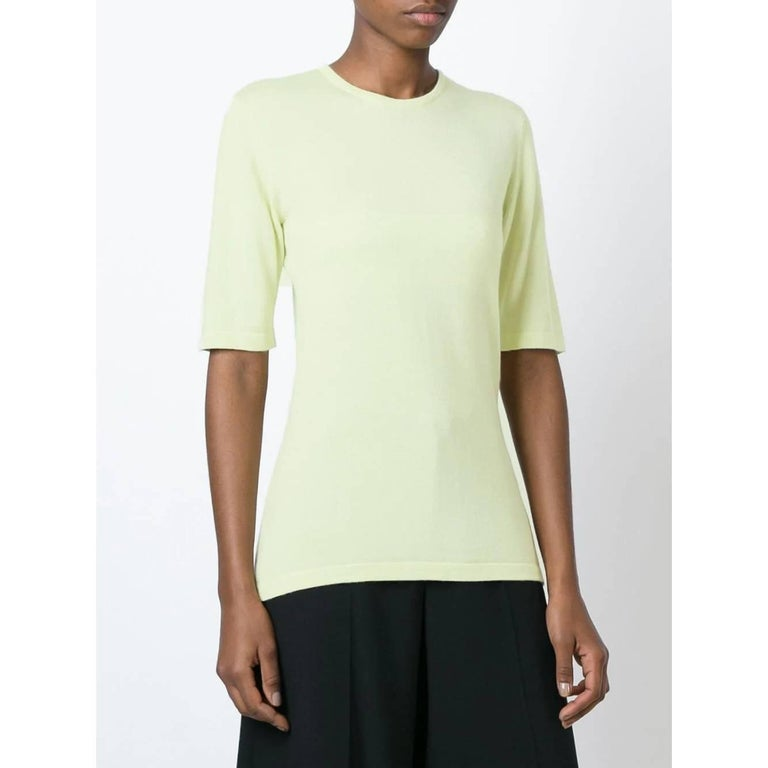 Céline mint green cashmere and silk blend sweater. Round neck and short sleeves.   Years: 90s  Made in Italy  Size: 3   Flat measurements  Height: 67 cm Shoulders: 38 cm  Bust: 42 cm Sleeves: 31 cm