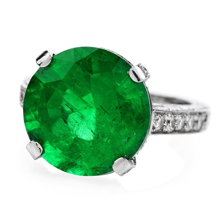 Let's Dazzle with this Colombian Emerald & Diamond Cocktail Ring!  This Excellent Condition cocktail ring is crafted in solid Platinum. Prominently featured in the center is an 8.13 ctsColombian Emerald,AGL Certified. No Enhancement, OnlyMinor