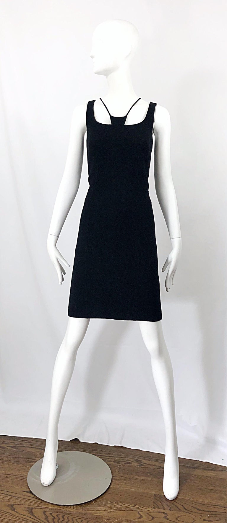 Rare early work by CHADO RALPH RUCCI! The classic little black dress, with a slight edge. Bondage inspired neck. Hidden curved zipper up a side back seam. Lightweight wool is perfect for any time of year. Fully lined. Couture quality one would