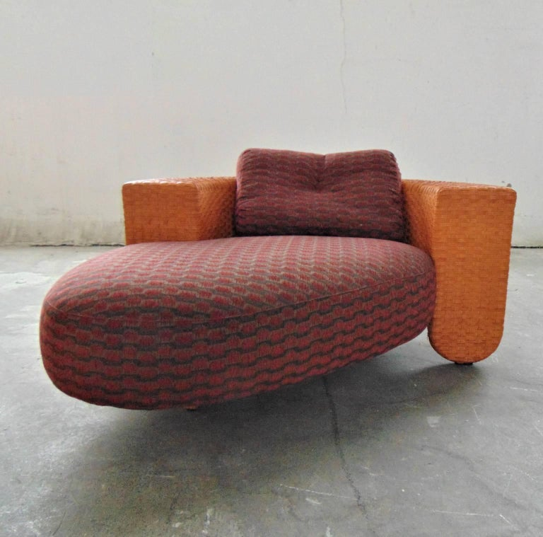 This patio chaise and daybed by Pierantonio Bonacina of the late 1990s has a wooden frame, woven tangerine leather strips and an extremely comfortable padded upholstered seat with a special COM fabric. The feet are in solid beechwood. The matching