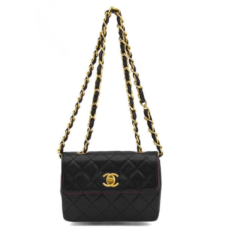 1990s Chanel Black Leather Mini Flap Bag  In Good Condition For Sale In Toronto, Ontario