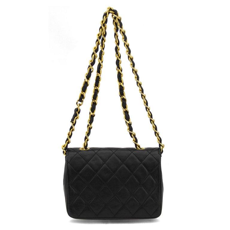 Women's or Men's 1990s Chanel Black Leather Mini Flap Bag  For Sale