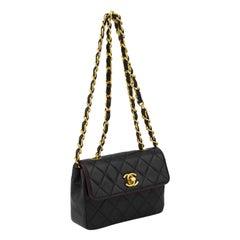 1990s Chanel Black Leather Mini Flap Bag