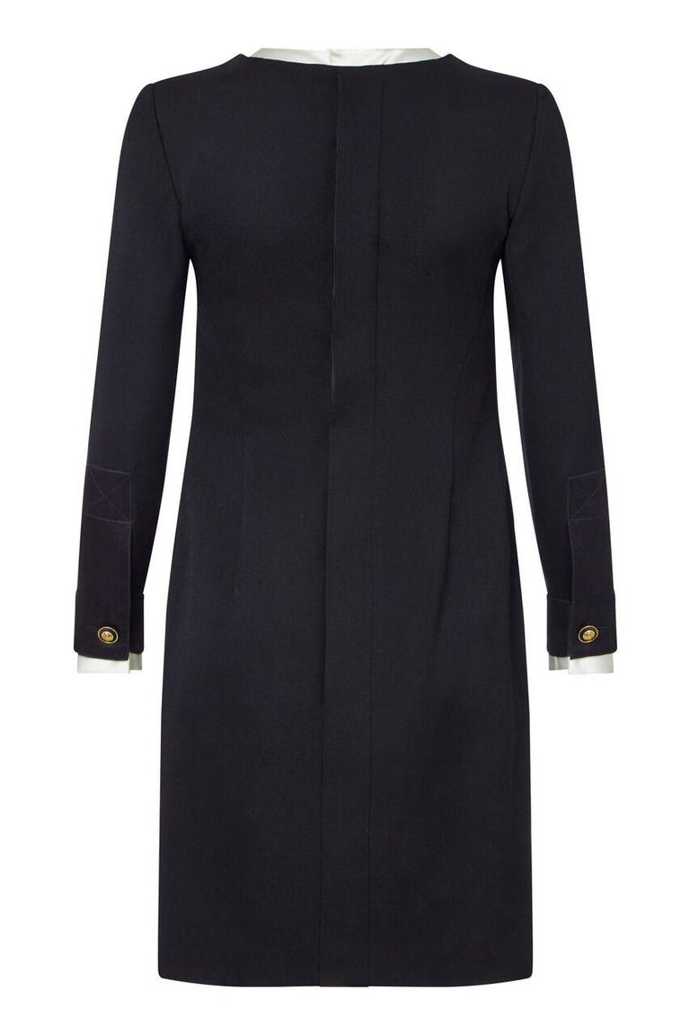 This beautiful late 1980s / early 1990s tuxedo dress by Chanel is of impeccable quality and construction. Effortlessly combining a formal aesthetic with an elegant evening look, the detachable soft cream silk satin collar and cuffs can be removed if