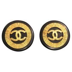 1990s Chanel Jumbo Black Gold Resin Button Earrings