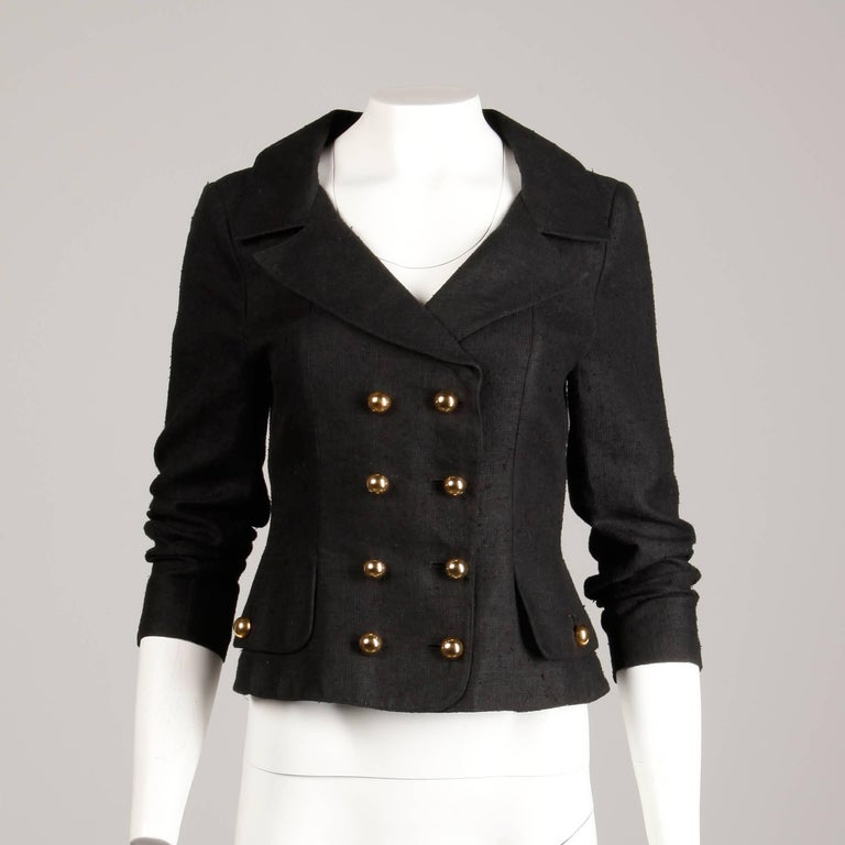 Military-inspired vintage jacket by Christian Lacroix in a linen/ silk blend. Fully lined with front button and hook closure. Shoulder pads are sewn in underneath the lining. 55% silk, 45% linen. The marked size is I 42/ F 40/ D 36/ GB 34/ BS 38/