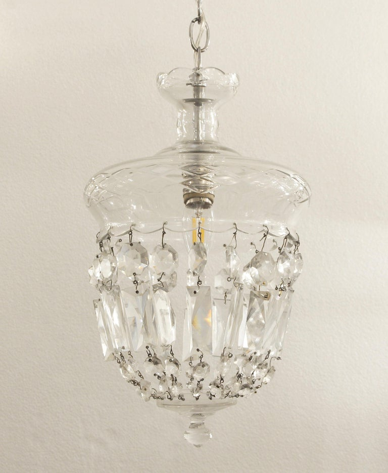 1990s clear glass pendant light with a chrome fitter and single socket. Done in a bell jar style. This can be seen at our 302 Bowery location in Manhattan.