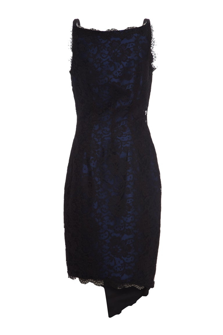 This desirable 1990s black lace cocktail dress with blue silk underlay is couture by British designer David Fielden and exudes quality. A favourite of figurative icons such as Elizabeth Taylor, Julia Roberts, Bette Midler, Bianca Jagger and Kate