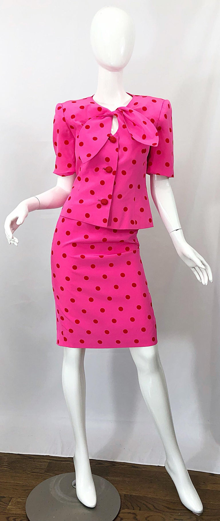 Chic vintage 90s DAVID HAYES for SAKS 5th AVENUE hot pink and red polka dot silk power skirt suit! Features a tailored short sleeve jacket with a tie at neck with keyhole below. Three red crystal embellished buttons up the front center. High waisted