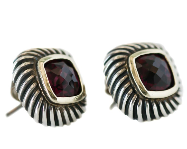 1990s David Yurman Cable Stud Earrings - 14 Karat Yellow Gold, Sterling Silver, Garnet  Features: Cushion cut faceted Garnet center stone 14 Karat Yellow Gold Bezel setting and Post Sterling Silver Cable Frame and earring back Earrings measure 14