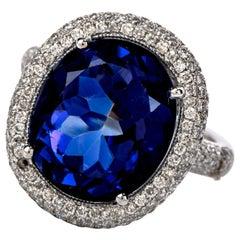 1990's Diamond Tanzanite 18 Karat Gold Oval Halo Cocktail Ring