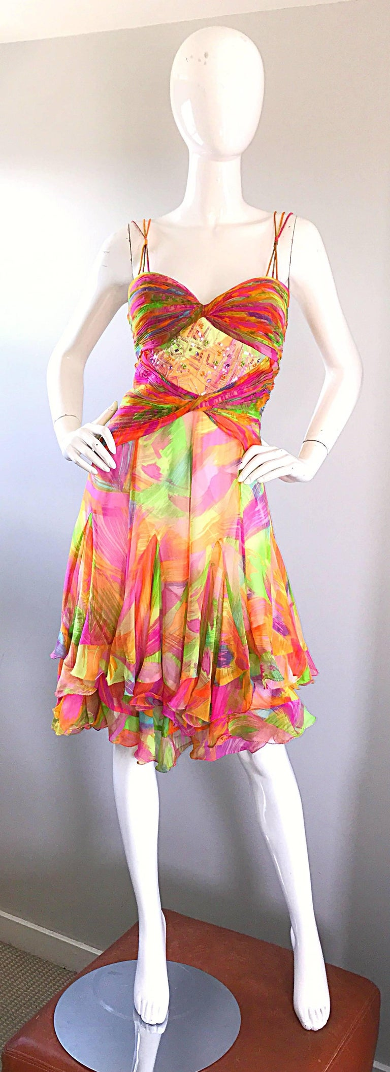 Insanely beautiful vintage (brand new with tags) 1990s DIANE FREIS bright neon silk chiffon dress! Features vibrant colors of pink, green, blue, orange and fuchsia throughout. Flattering ruched detail at stomach and bust. Triple strand straps at