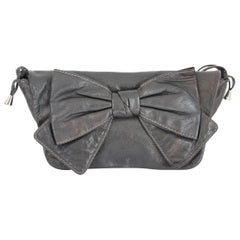 1990s Dolce & Gabbana Maika Black Leather Bow Shoulder Bag