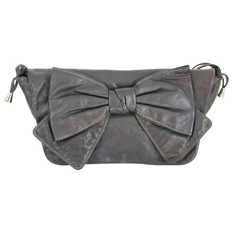 1990s Dolce & Gabbana Maika Black Leather Bow Shoulder Bag For Sale