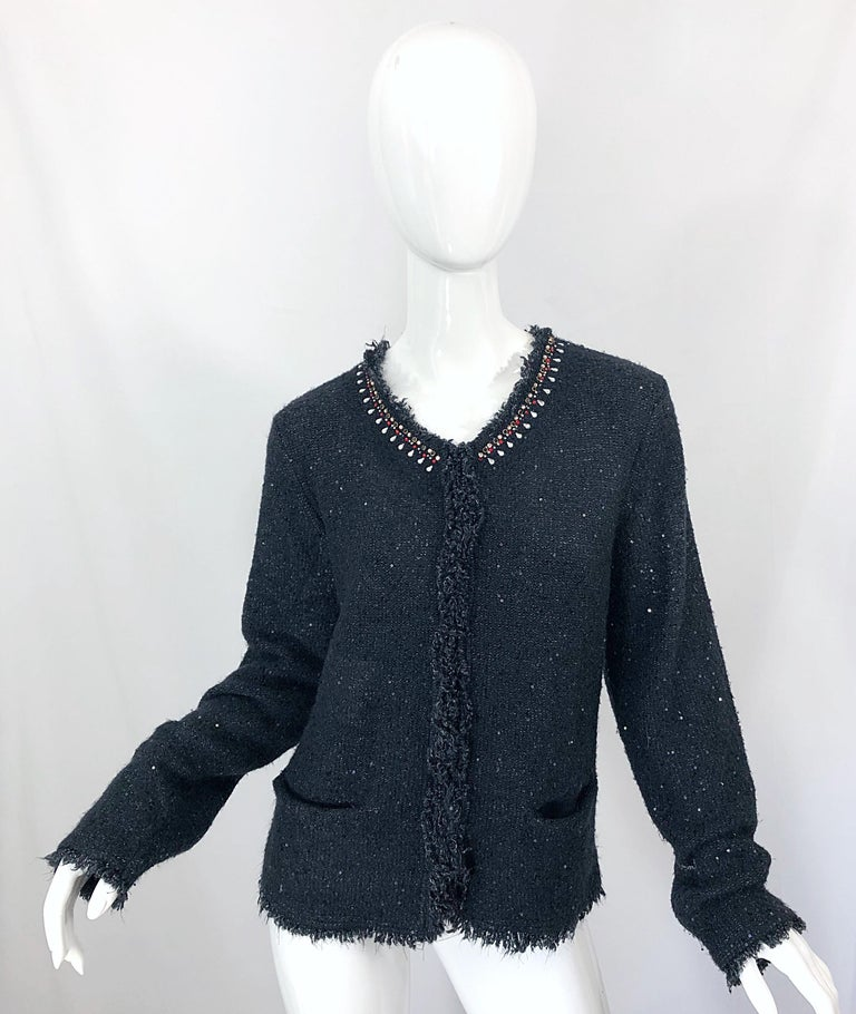 Beautiful 90s DONNA KARAN sequined, beaded and rhinestone long sleeve black cardigan. Soft blend of acrylic, nylon and spandex feels amazing against the skin. POCKET at each side of the waist.  Hidden hook-and-eye closures up the front. Hundreds of