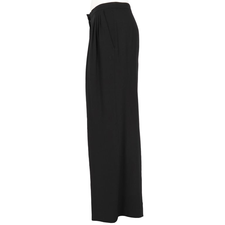 Dries Van Noten black trousers, high waist, button, snap button and zip closure, decorative darts at the waist and side welt pockets. Years: 1990s  Made in Belgium  Size: 36 FR  Measurements: Linear measures  Height: 97 cm Waist: 36 cm