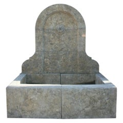 1990s Elegant Hand Carved Aged Stone Antique Style Wall Fountain