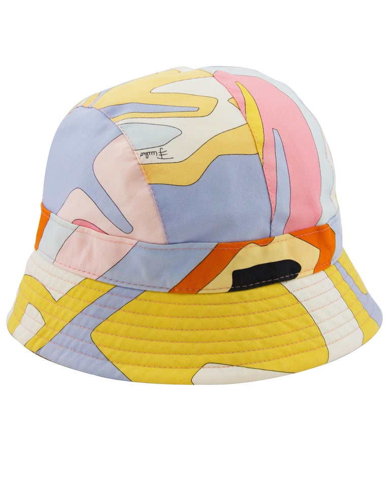 Emilio Pucci purple, pink, black and yellow abstract printed canvas bucket hat from the late 1990s, early 2000s. A snug fit with a clean white interior and cream stitching along the brim. Ribbed brim. In excellent vintage condition.