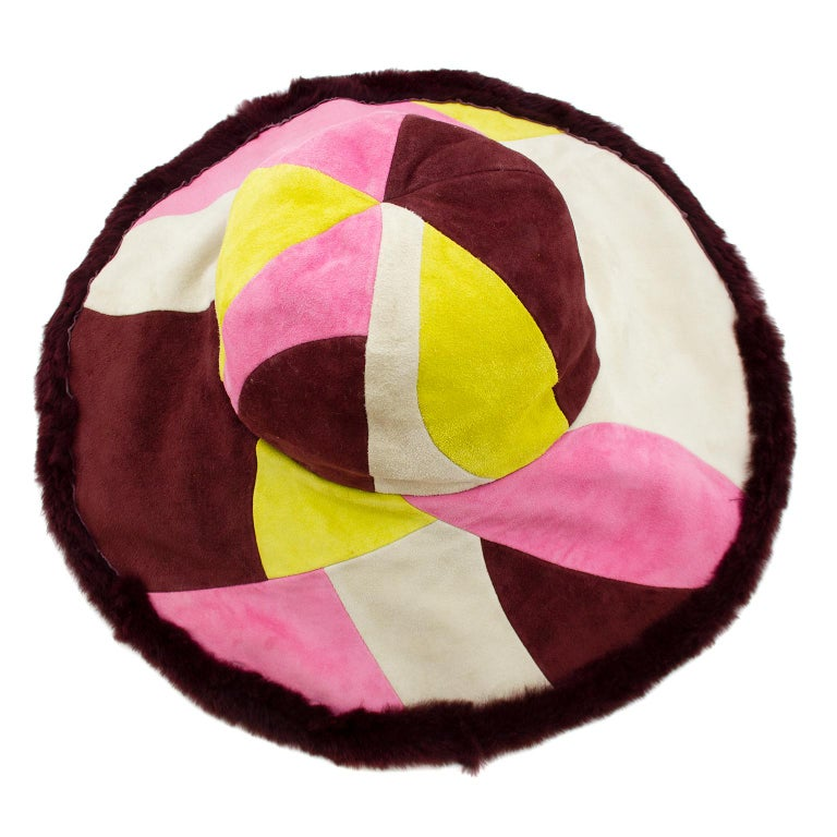 1990s Emilio Pucci six panel wide brim hat. The iconic Pucci pattern made out of patchwork suede in pink, cream, maroon and yellow. Maroon sheared rabbit trim and interior. Very chic winter chapeau. Made in Italy. Excellent vintage condition - tags