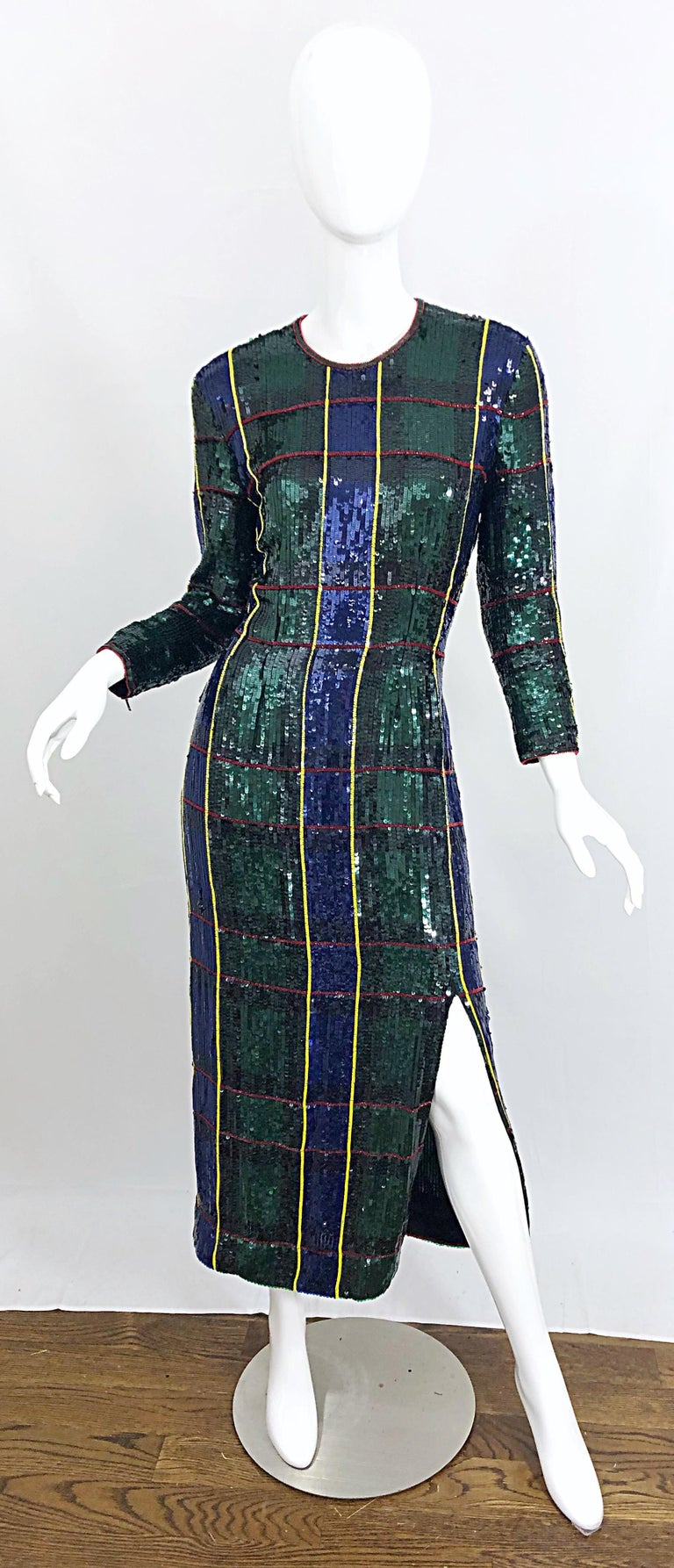Beautiful vintage 90s ESCADA COUTURE fully sequined tartan plaid silk evening gown! Features a vibrant hunter green, navy blue, yellow and red plaid pattern throughout the entire dress. Thousands of hand-sewn sequins. Tailored long sleeves have