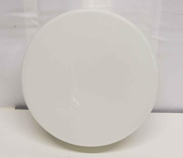 Round white 1990s Mid-Century Modern style French opaline glass flush mount fixture with a white steel base. Small quantity available at time of posting. Please inquire. Priced each. This can be seen at our 400 Gilligan St location in Scranton, PA.