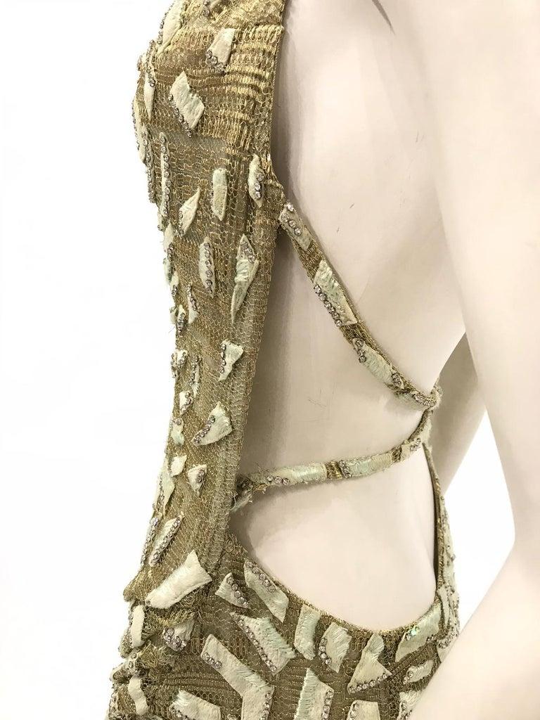 1990'S GIANNI VERSACE ATELIÉR Metallic Gold Lamé Lace Gown Covered In Crystals & Velvet Appliqués