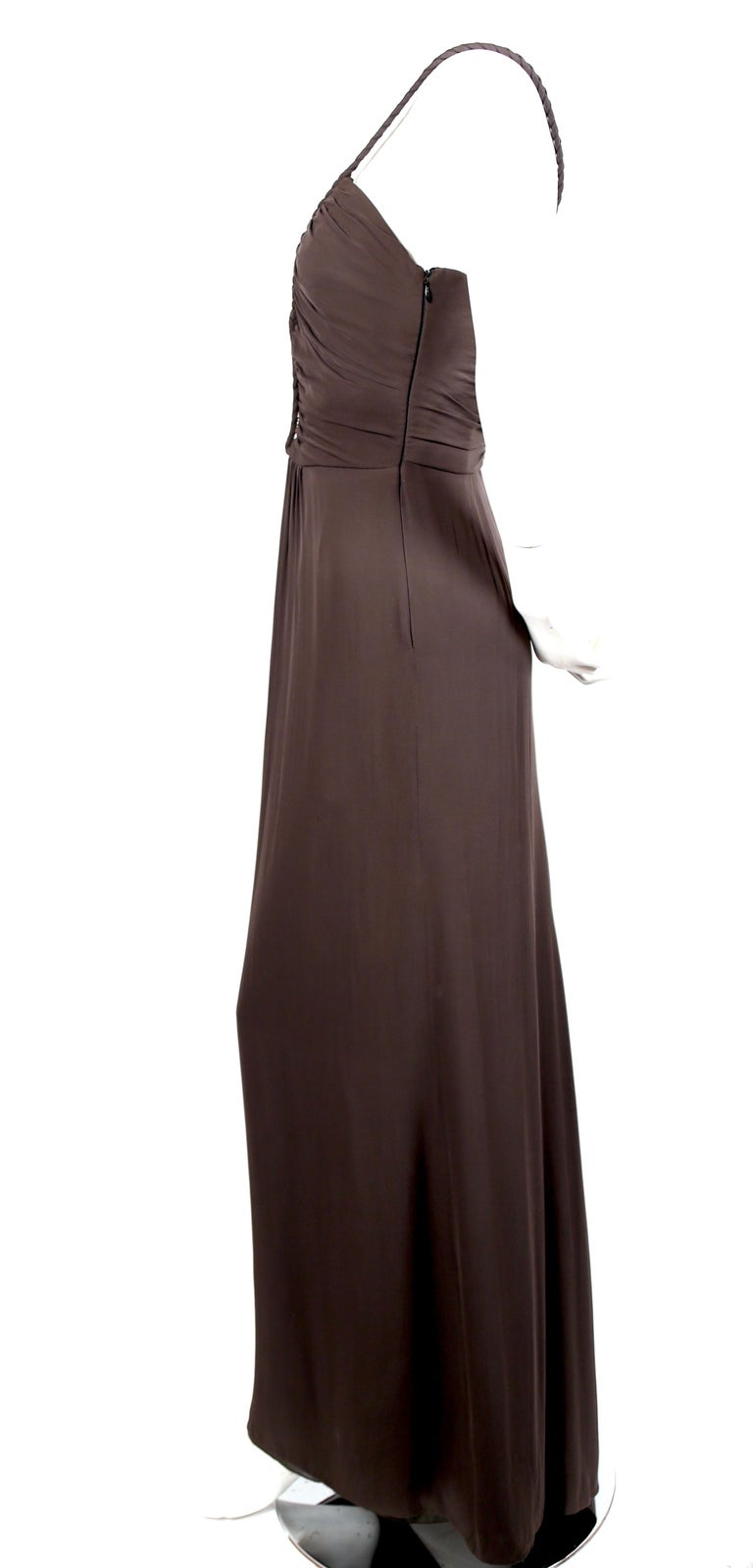 Dark-brown, full-length, Grecian silk dress with braided straps designed by Giorgio Armani for Armani Collezioni dating to the 1990's. Labeled an Italian size 40 or US 4. This dress best fits a modern U.S. size 2-4. Approximate measurements: bust