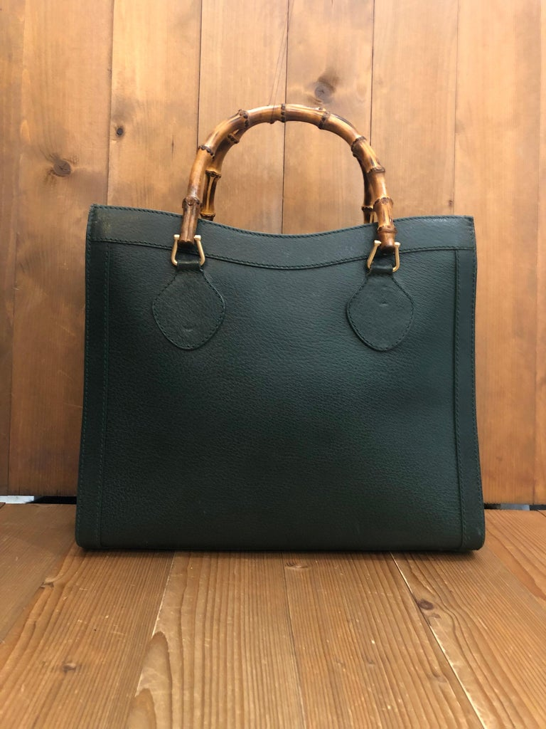 1990s Gucci bamboo tote in a unique and rare dark green color. The Bamboo tote is one of Princess Diana's favorite purses. Interior fully refurbished. Gucci revamped this Bamboo tote in 2021 winter collection.   Material: Pigskin